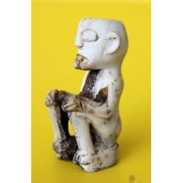 Papua New Guinea carved sitting bone figure 19/20th century